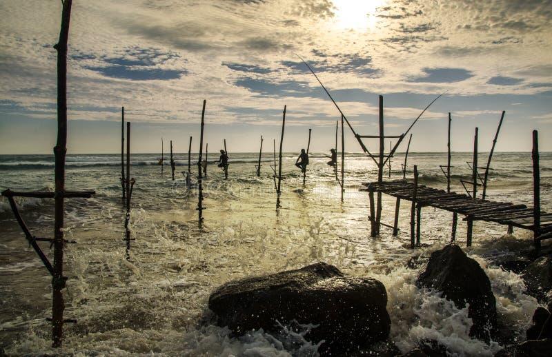 Stilt fishermen in Sri Lanka. Traditional stilt fishermen in Sri Lanka stock image