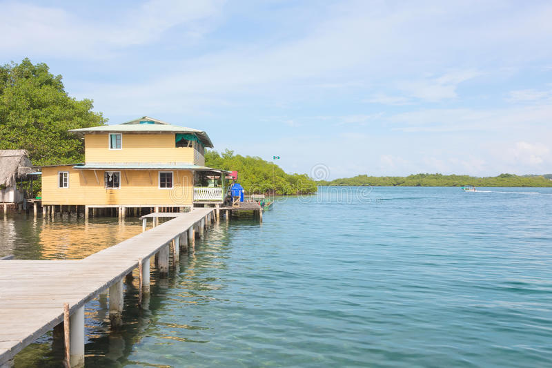 Caribbean Houses Over The Sea With Wooden Dock And Bungalows On Stilts