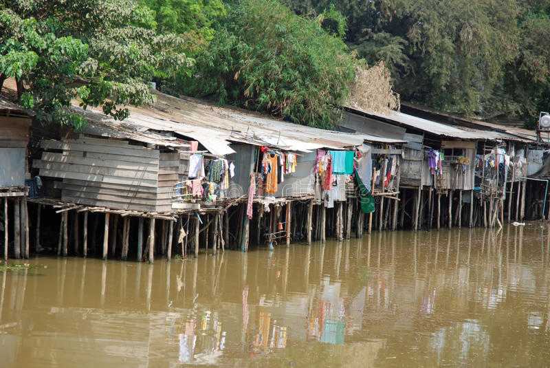 Stilt houses - was mirror in water-Cambodia. Homes on stilts with drying was mirror in water, Nearby Tonle Sap and Siem Reap, Cambodia, Asia stock photo