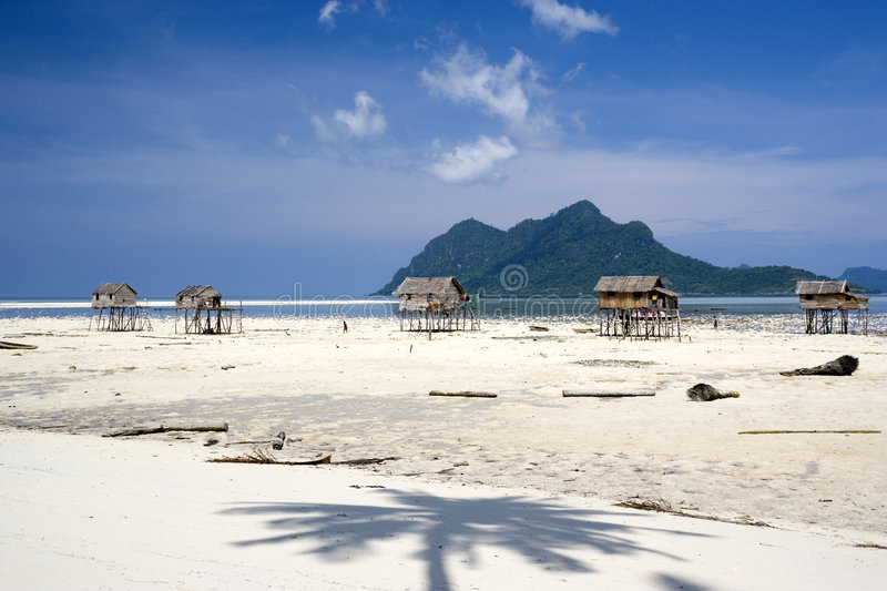 Stilt huts on tropical beach royalty free stock photography