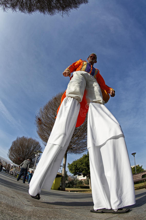 Stilt man. Circus man walking in a park on a Sunday holiday. In the celebrations of Palma de Mallorca many activities to the streets for adults and children are