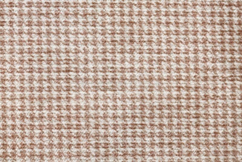 Stilvolle Gewebebeschaffenheit mit ehrfürchtiger Oberfläche Brown, weißer Textilhintergrund stockfoto