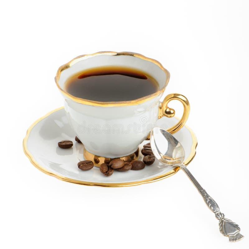 Stilvolle Kaffeetasse mit silbernem Löffel und Startwert für Zufallsgenerator lizenzfreies stockbild