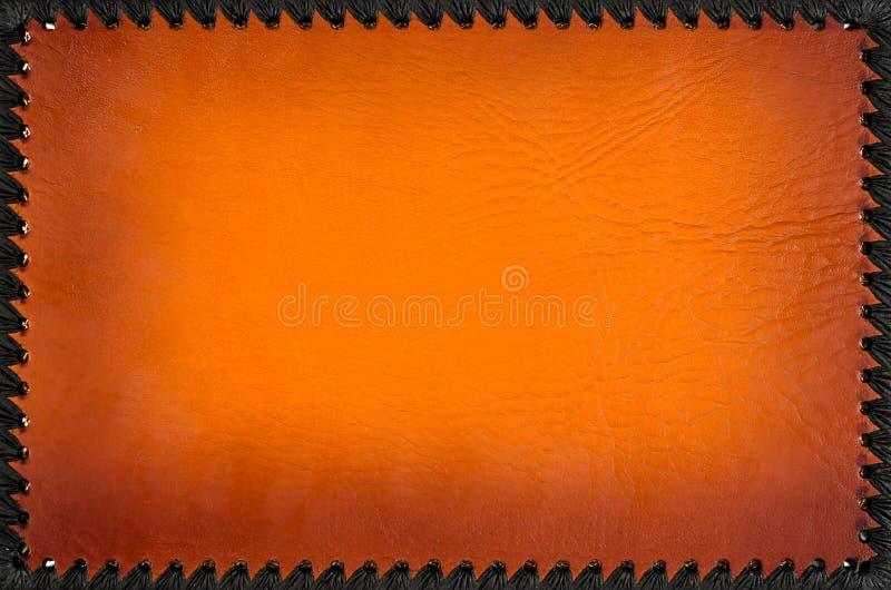 Stilvolle orange lederne Fotoalbumabdeckung mit schwarzem Rahmen stockfotografie