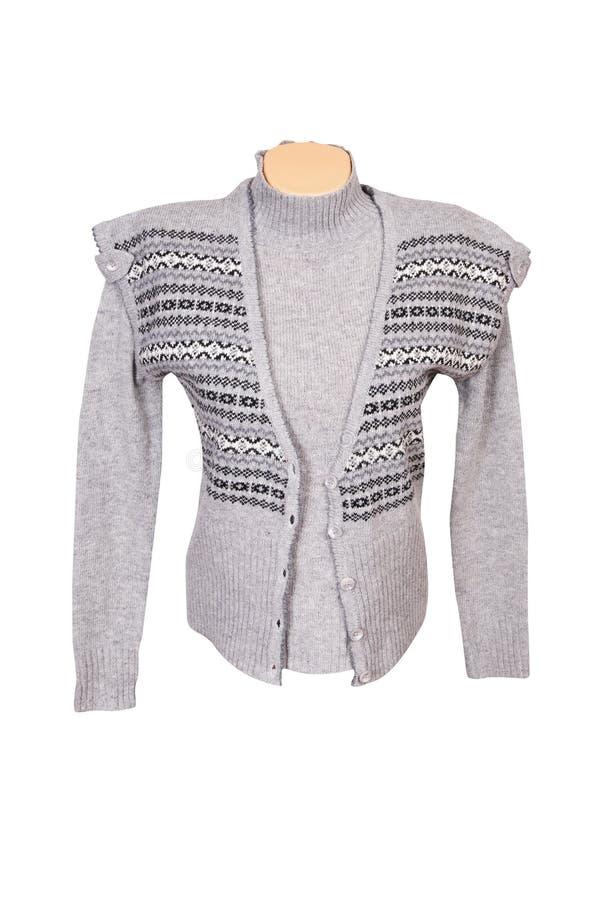 Stilvolle warme Weste und Strickjacke auf einem Weiß lizenzfreies stockfoto