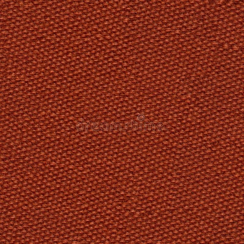 Stilvoller dunkelbrauner, orange Gewebehintergrund auf Makro lizenzfreies stockbild