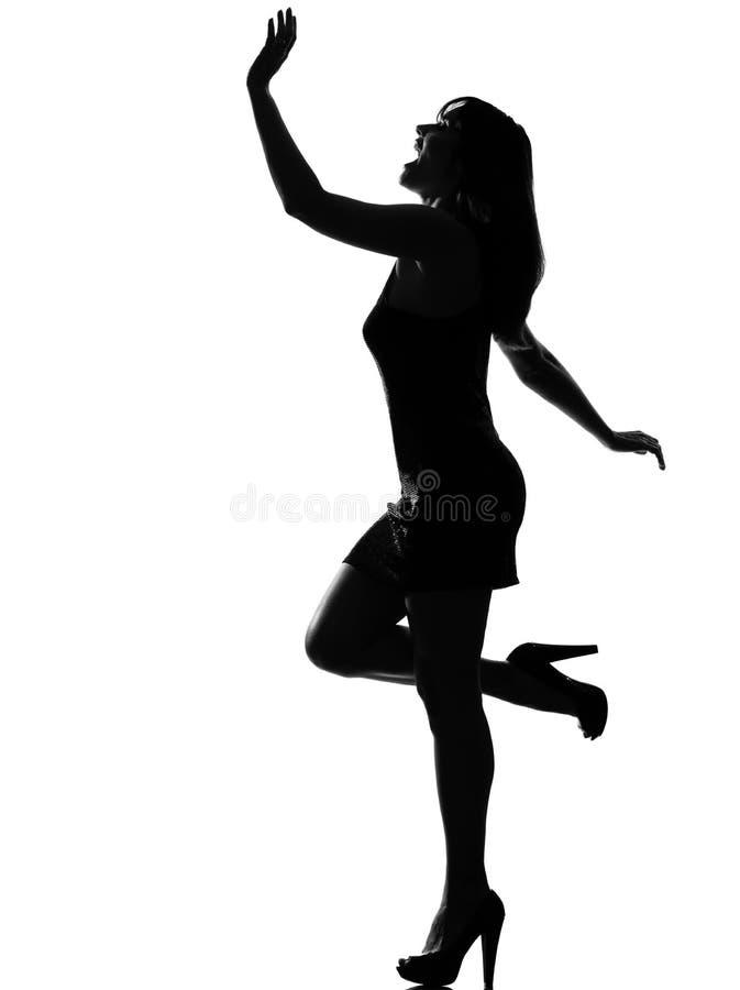 Stilvolles Schattenbildfrauentanzen glücklich stockfoto