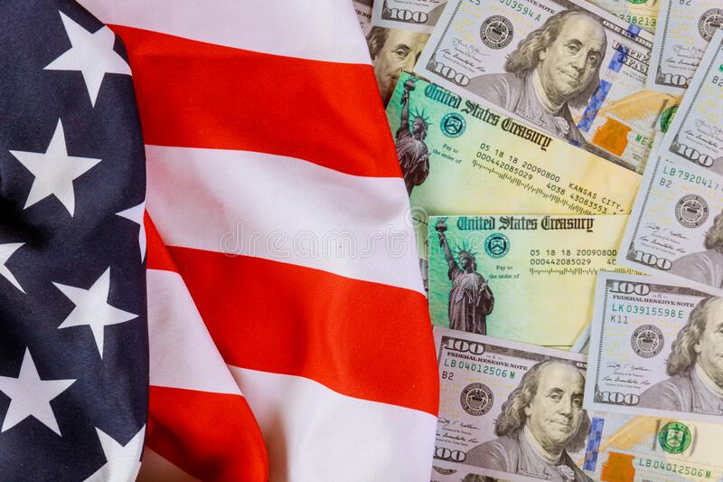 Stimulus American economic tax return check with US flag and USA dollar banknote. Stimulus American economic tax return check with US flag and USA dollar cash royalty free stock photo