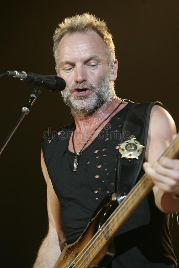 The Police performs in concert. Sting with The Police performs in concert at the Cruzan Amphitheatre in West Palm Beach, Florida on May 17, 2008 royalty free stock photo