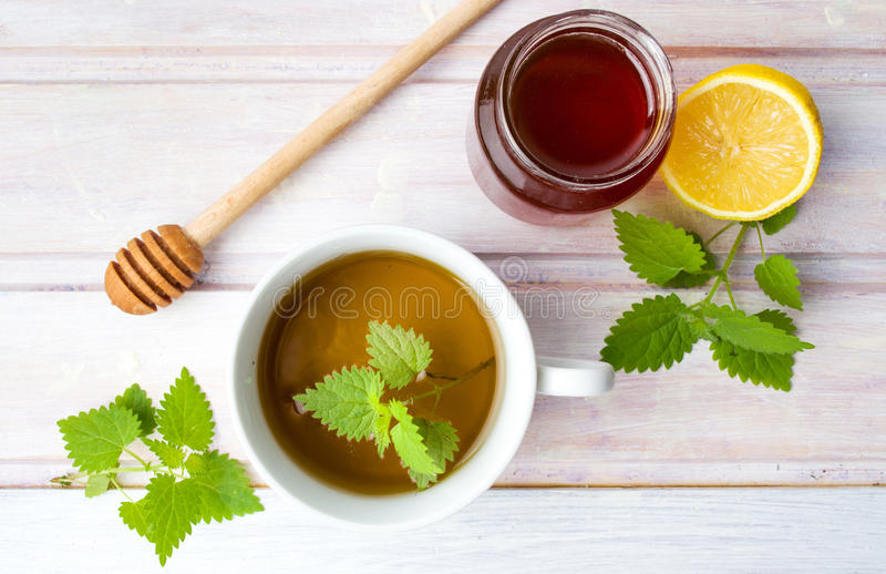 Stinging nettle tea with honey and lemon. Top view royalty free stock images