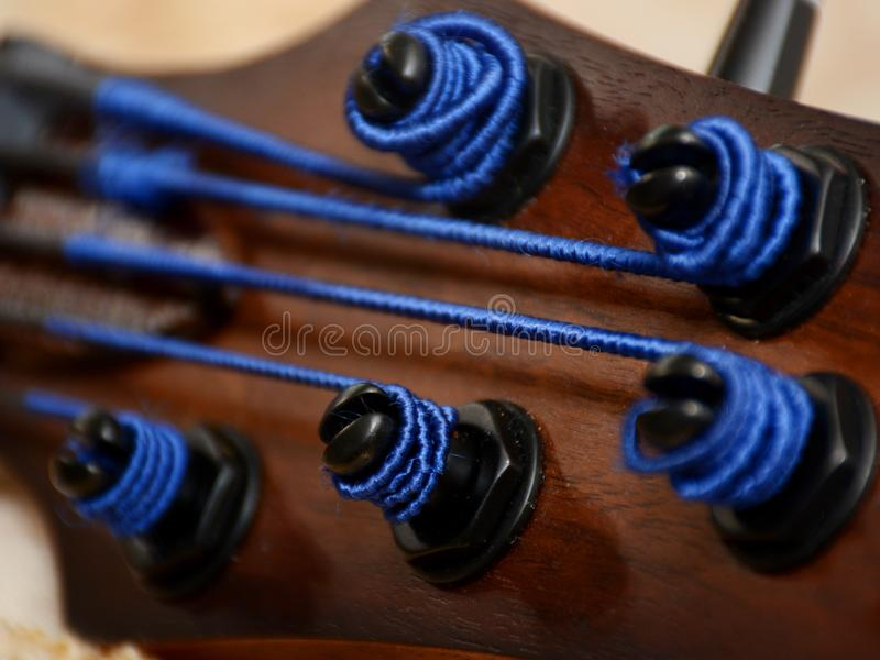 5 Srings Fretless Bass Guitar with Black Strings. 5 Stings Bass Guitar wood Color With Black Strings and Black Accesories royalty free stock photo
