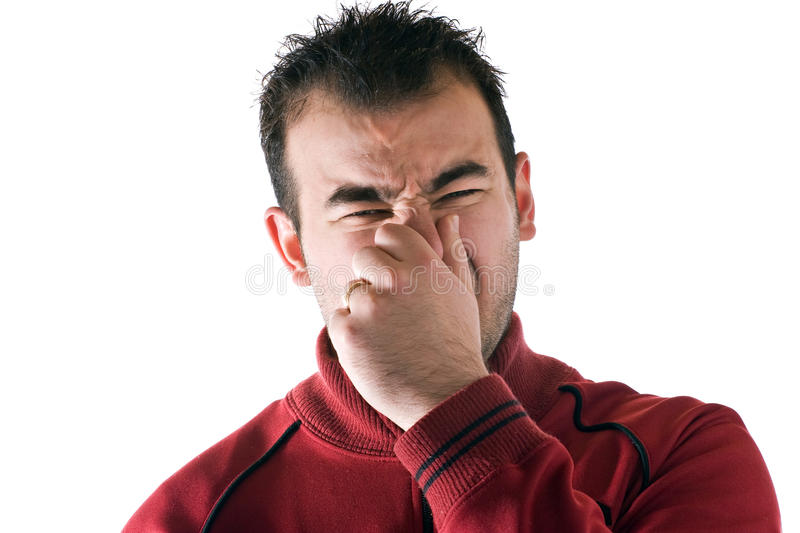 Stinky Smell. A young man holds or pinches his nose shut because of a stinky smell or odor royalty free stock images