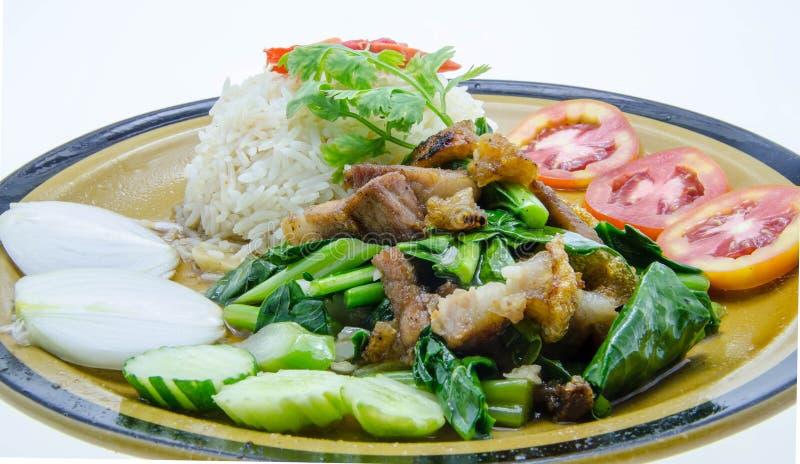 Stir-зажаренная листовая капуста с кудрявыми свининой и рисом стоковое фото