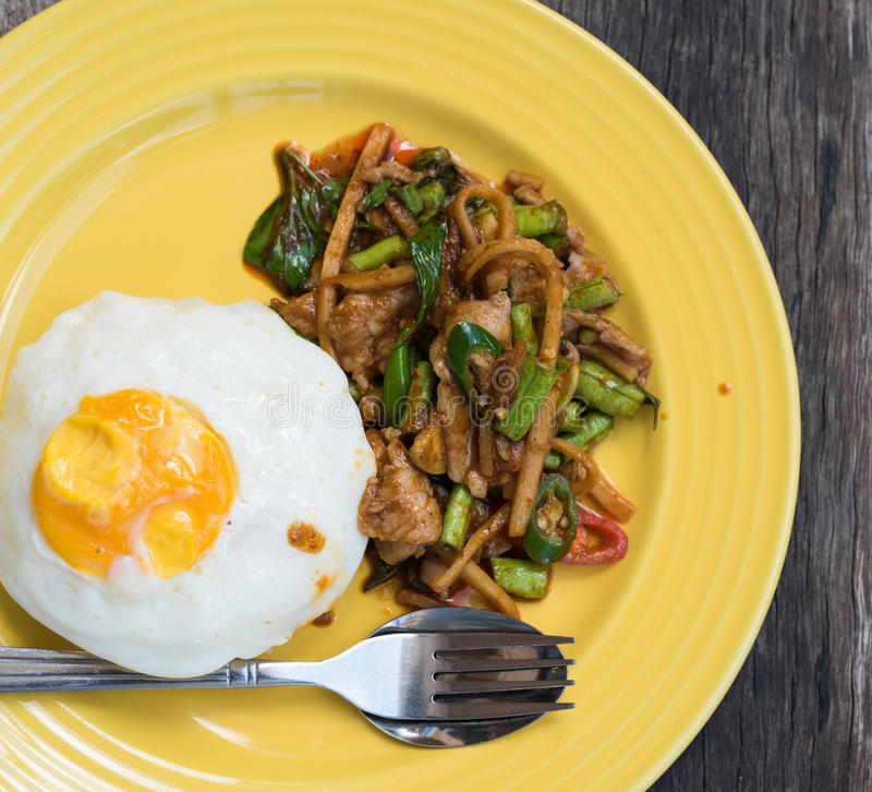 Stir curry rice with fried egg. The stir curry rice with fried egg stock image