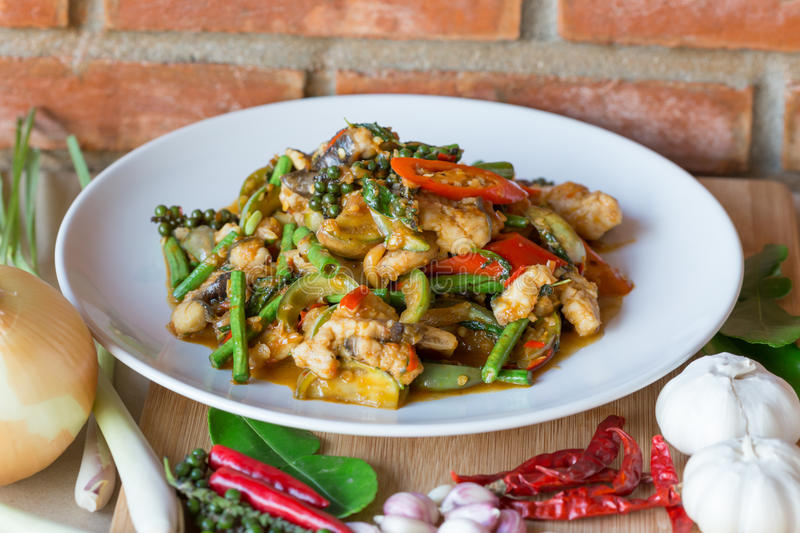 Stir fish with spicy curry stock images