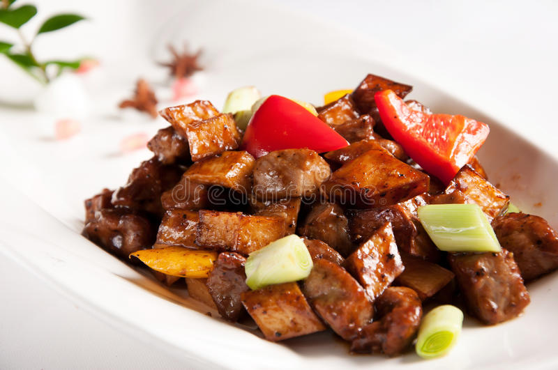 Stir fried beef with black pepper and mushroom. Chinese cuisine-Stir fried beef with black pepper and mushroom stock images