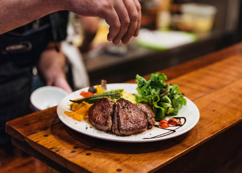 Stir fried beef steak served with vegetable side dish and salad topping with balsamic dressing.  stock photography