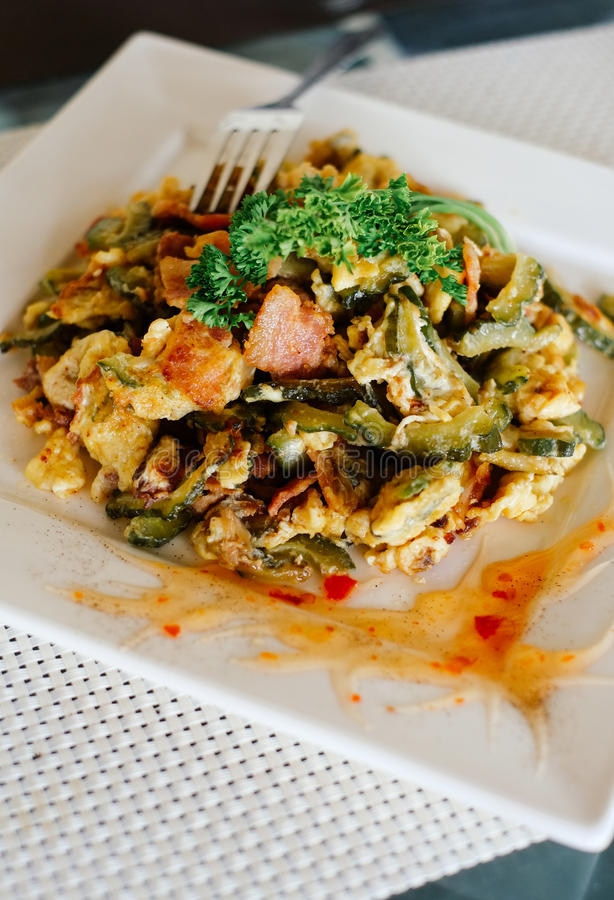 Stir Fried Bitter Melon with Eggs and bacon royalty free stock photo