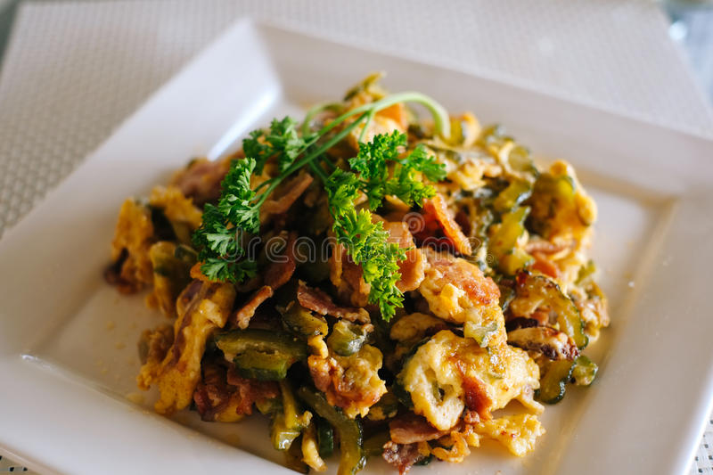Stir Fried Bitter Melon with Eggs and bacon stock images