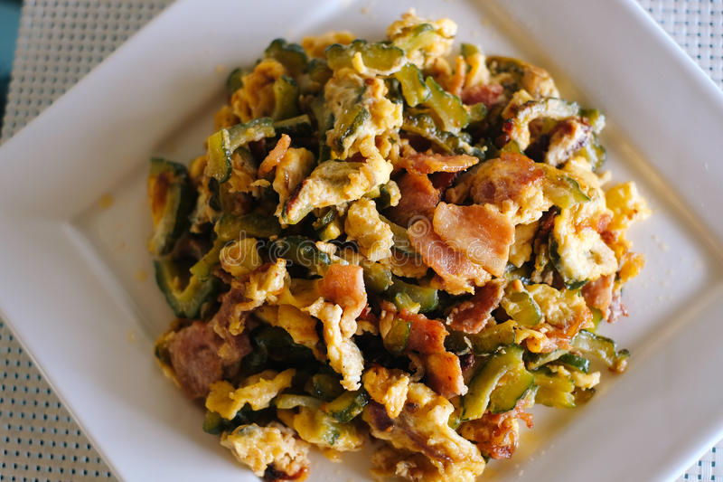 Stir Fried Bitter Melon with Eggs and bacon royalty free stock photography