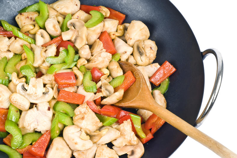 Stir Fried Cashew Chicken. A wok full of stir fried chicken with cashew nuts and vegetables royalty free stock images