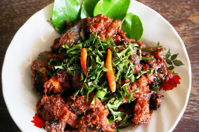 Stir-Fried Catfish fishes. Asia - Asian food, Thaifood, phad phed pla duk thod krob: Stir-Fried Catfish fishes in spicy curry sauce on white plate on wooden stock images
