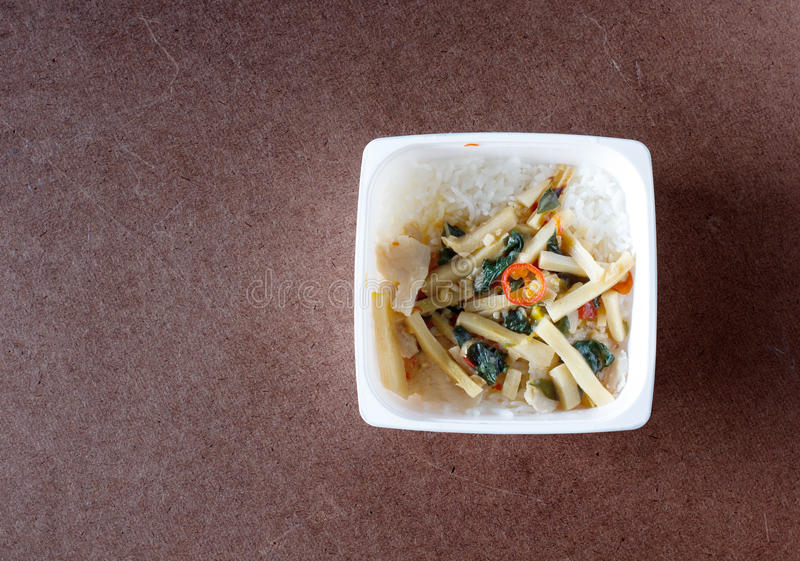 Stir-fried chicken with chili paste and bamboo shoots in food co stock images