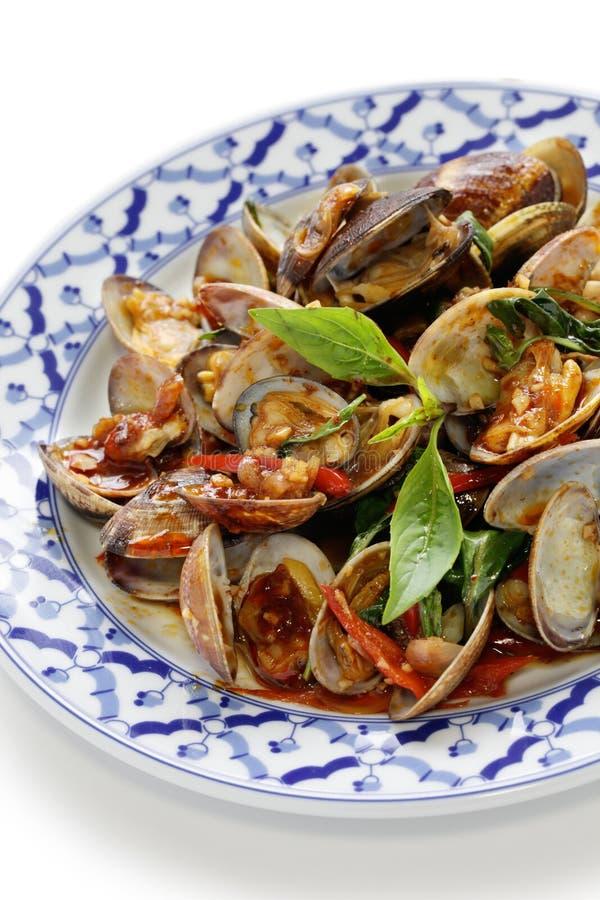 Stir fried clams with thai sweet basil. Stir fried clams with roasted chili paste and thai sweet basil, thai cuisine stock image