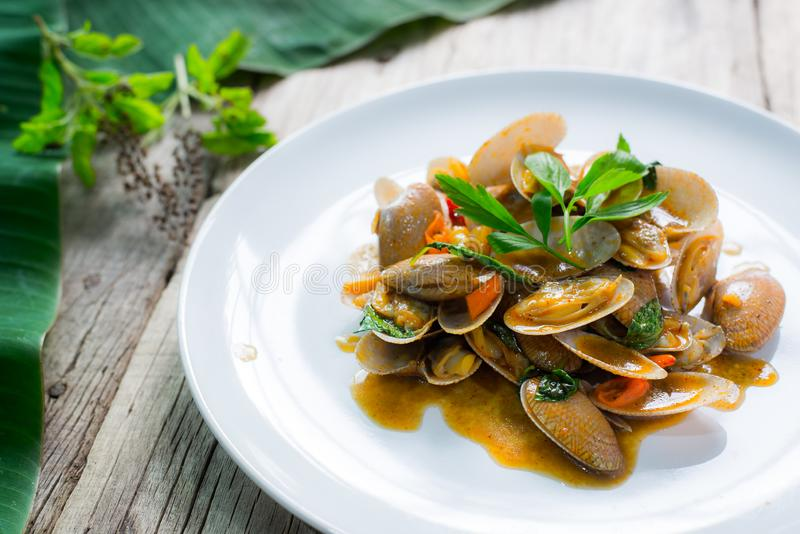 Stir fried clams with thai sweet basil, thai food.  stock images