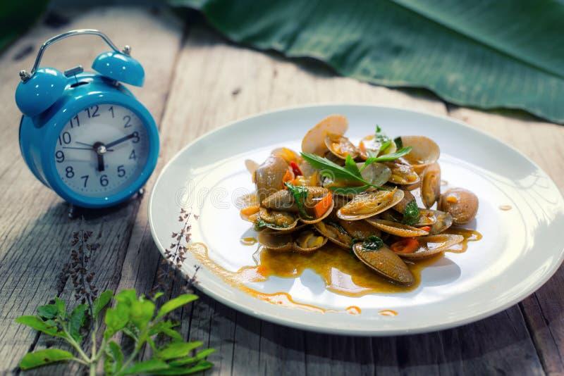 Stir fried clams with thai sweet basil, thai food.  stock image