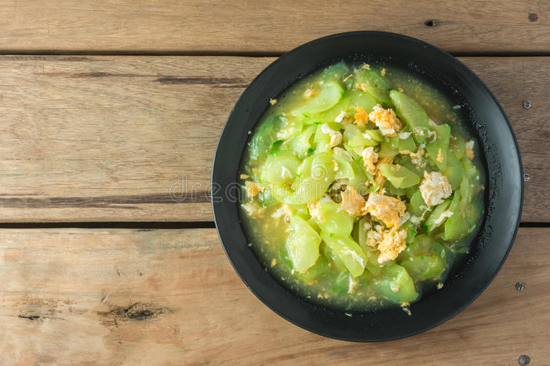 Stir Fried Cucumber on wooden table. royalty free stock photo
