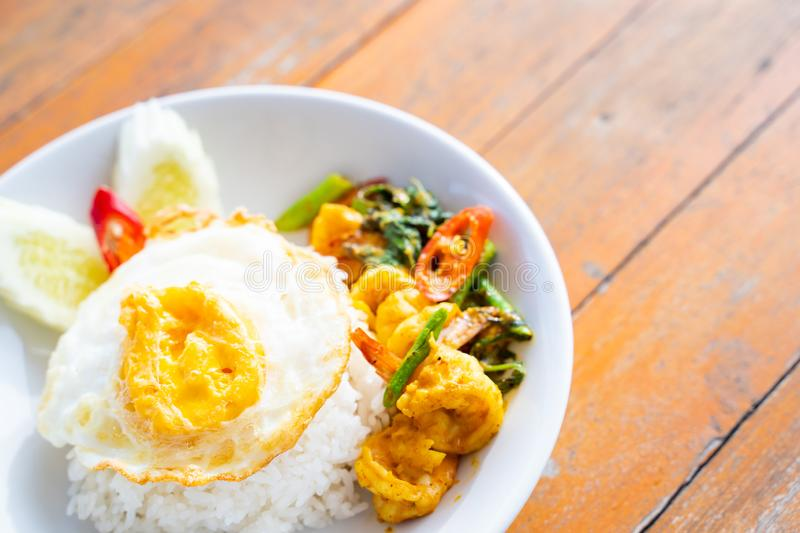 Stir fried curry with shrimp and fried egg. Thai food stock images