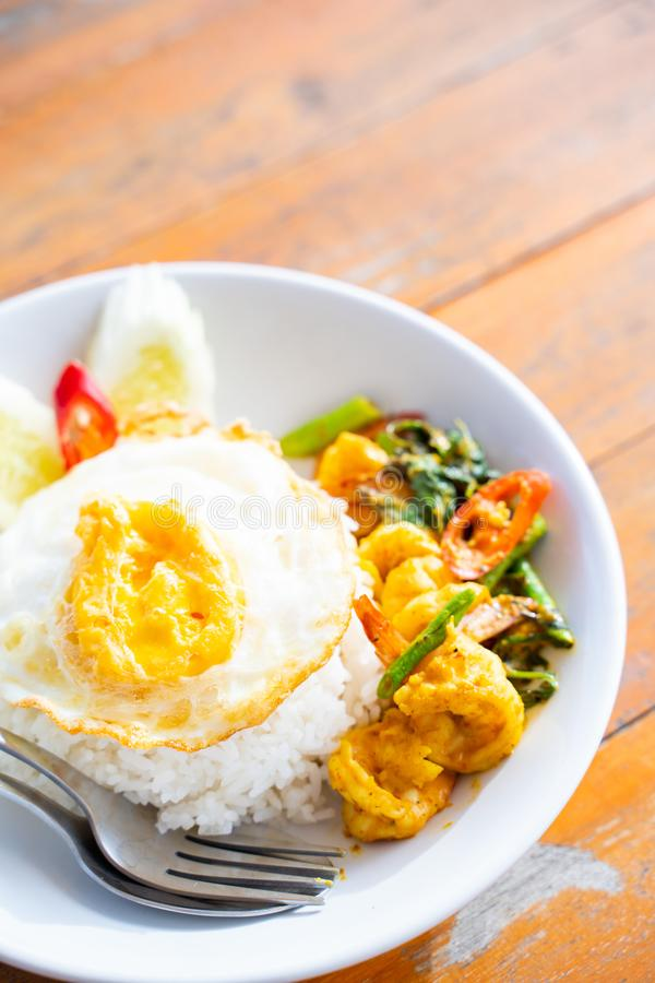 Stir fried curry with shrimp and fried egg. Thai food stock image