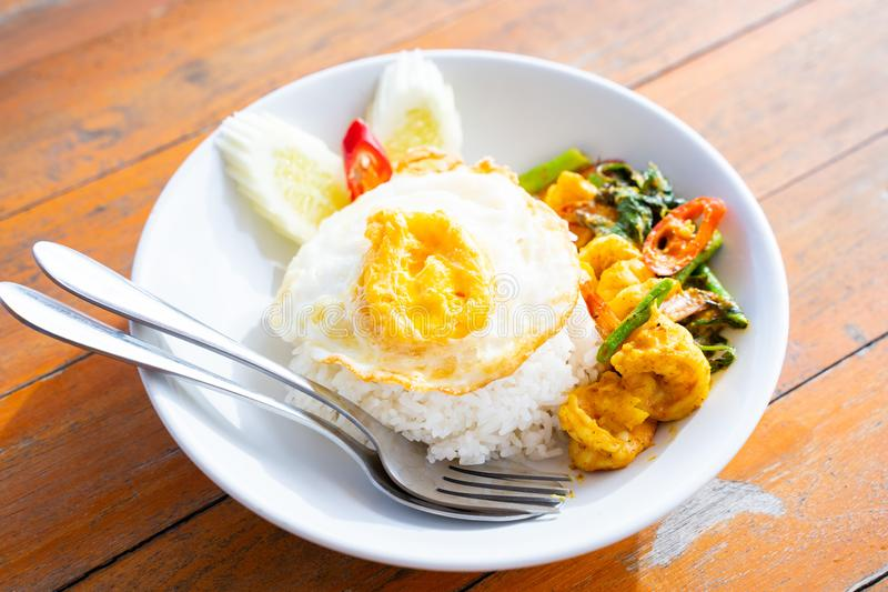 Stir fried curry with shrimp and fried egg. Thai food stock photo