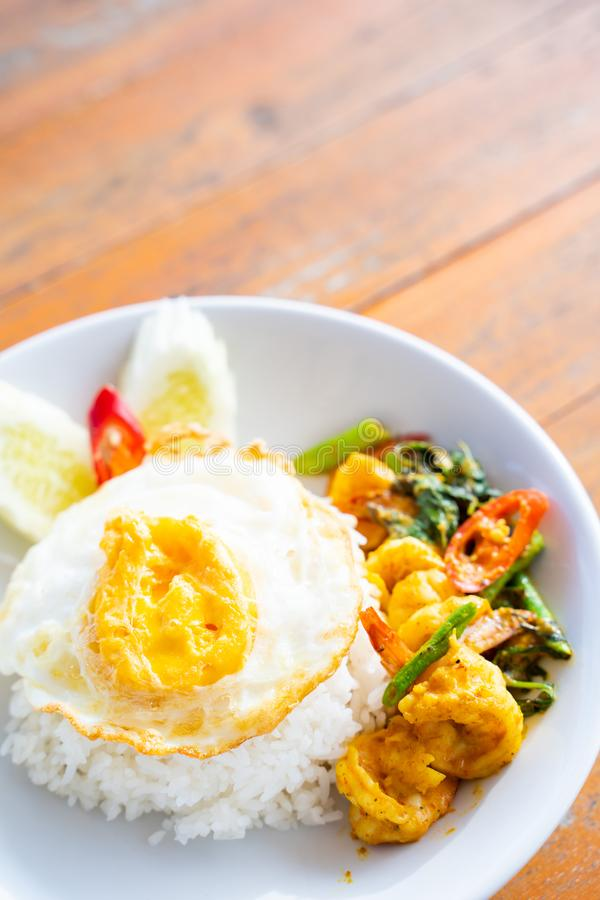 Stir fried curry with shrimp and fried egg. Thai food stock photography