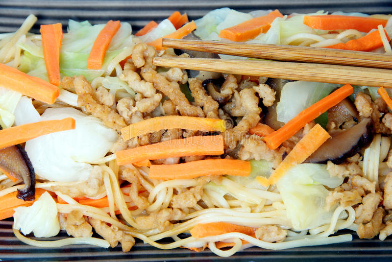 Stir-fried egg noodles with mix vegetables and ground tofu. stock images