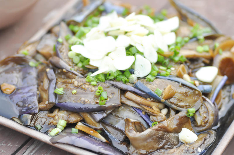 Stir fried eggplant with green shallot royalty free stock photos