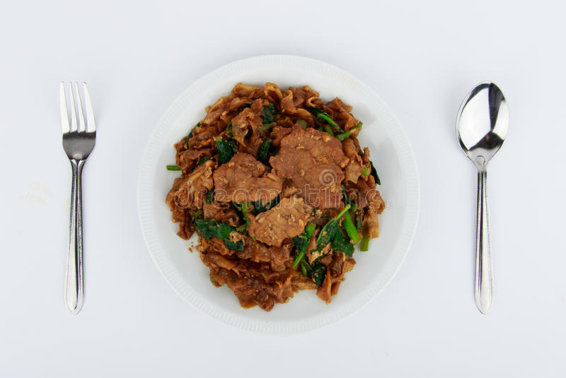 Stir fried flat noodle and pork with dark soy sauce. Stir fried flat noodle and pork with dark soy sauce (Thai people called Pad See Ew stock photography