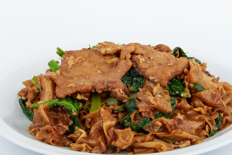 Stir fried flat noodle and pork with dark soy sauce. Stir fried flat noodle and pork with dark soy sauce (Thai people called Pad See Ew stock photo