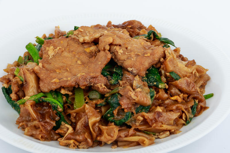 Stir fried flat noodle and pork with dark soy sauce. Stir fried flat noodle and pork with dark soy sauce (Thai people called Pad See Ew stock image