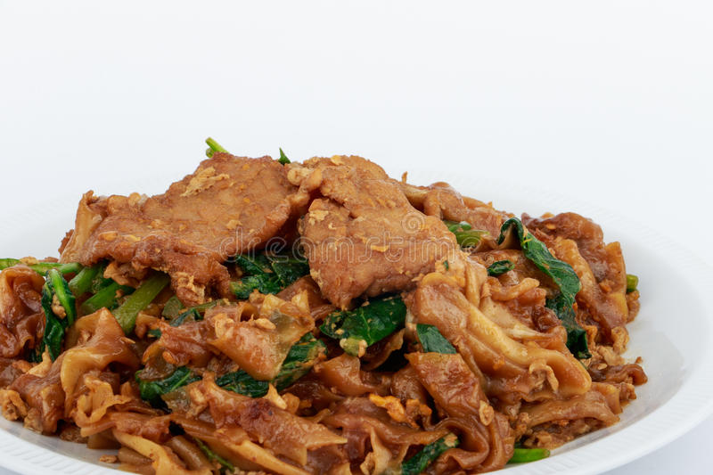 Stir fried flat noodle and pork with dark soy sauce. Stir fried flat noodle and pork with dark soy sauce (Thai people called Pad See Ew royalty free stock photos