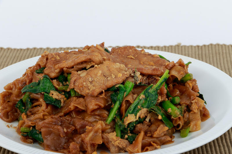 Stir fried flat noodle and pork with dark soy sauce. Stir fried flat noodle and pork with dark soy sauce (Thai people called Pad See Ew royalty free stock photography