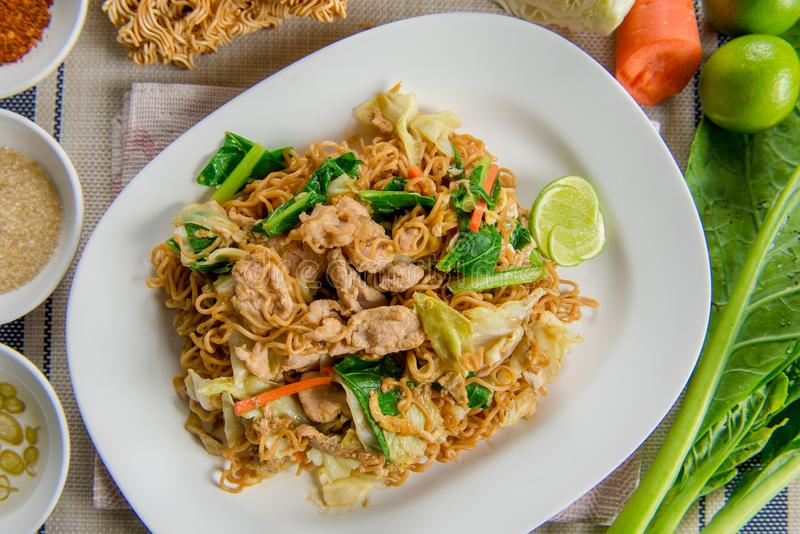 Pad See Ew Stir fried flat noodle and pork. Stir fried flat noodle and pork with dark soy sauce Thai people called Pad See Ew royalty free stock photography
