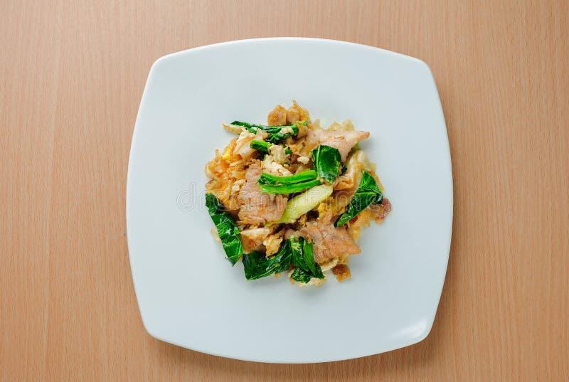 Stir fried flat noodle with pork & x28;Pad se ew moo& x29; royalty free stock photography