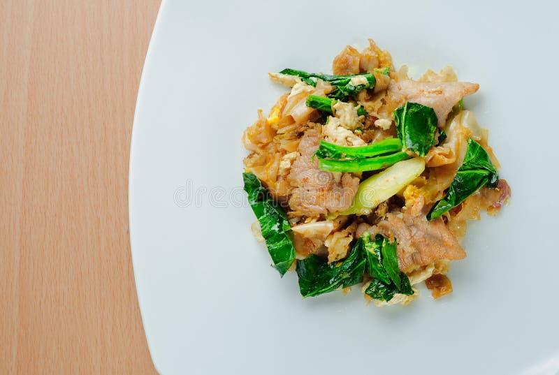 Stir fried flat noodle with pork Pad se ew moo. Stir fried flat noodle and pork with dark soy sauce Thai people called Pad See Ew stock photo