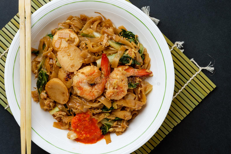 Stir fried flat rice noodle. Or char kway teow that is famous among Indonesian, Malaysian and Singaporean as breakfast or another meal royalty free stock photos