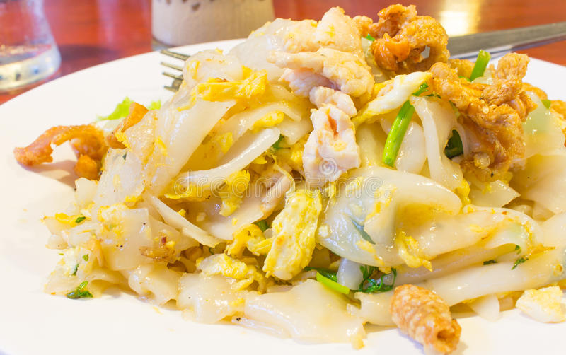 Stir-fried fresh rice-flour noodles with chicken and egg stock photo
