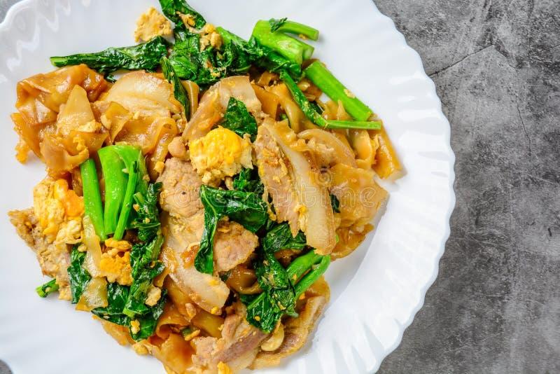Stir-fried Fresh Rice-flour Noodles With Sliced Pork, Egg and Kale. stock images