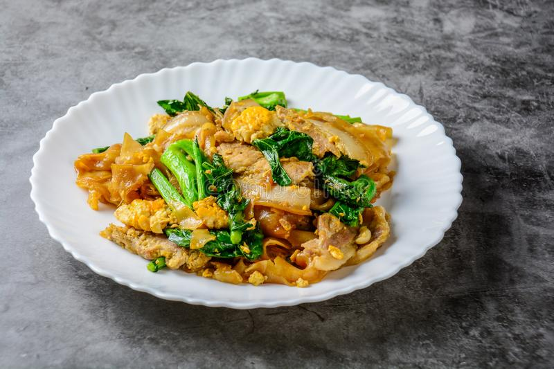 Stir-fried Fresh Rice-flour Noodles With Sliced Pork, Egg and Kale. stock photo