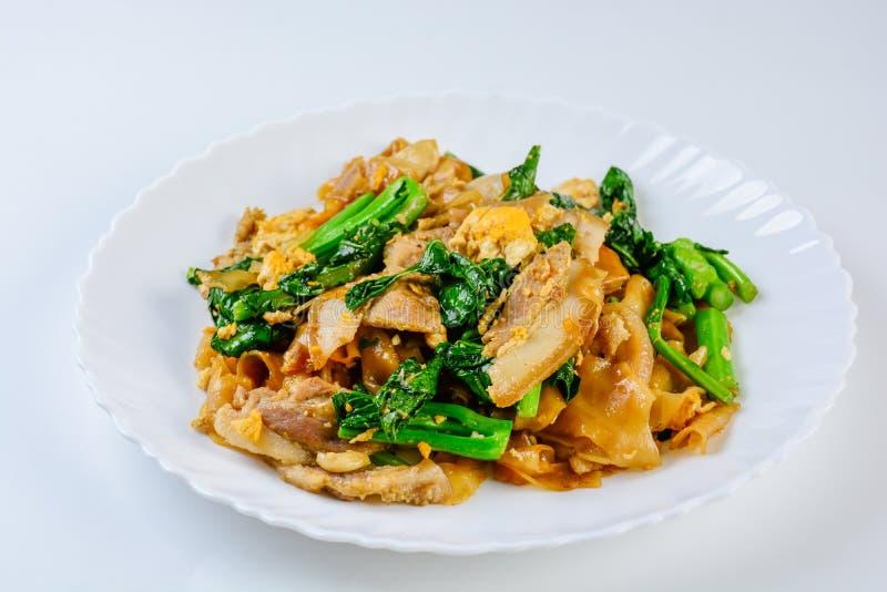 Stir-fried Fresh Rice-flour Noodles With Sliced Pork, Egg and Kale. stock image